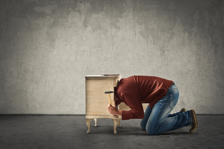 forniture: Man fixing forniture