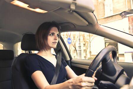 driving a car: Woman driving a car Stock Photo