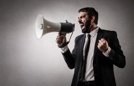 rigor: Businessman shouting into a megaphone