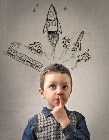 child school: Young boy daydreaming