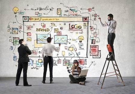 Colleagues working on a website Foto de archivo