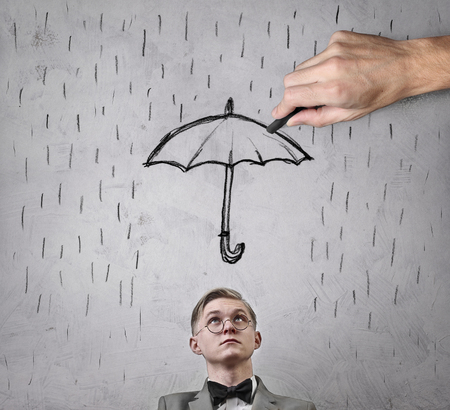 people looking up: Man sheltered by an umbrella