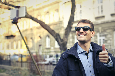 Man using a selfie stick photo