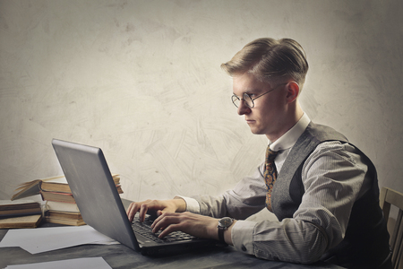 creative writer: Retro dressed man using a laptop Stock Photo