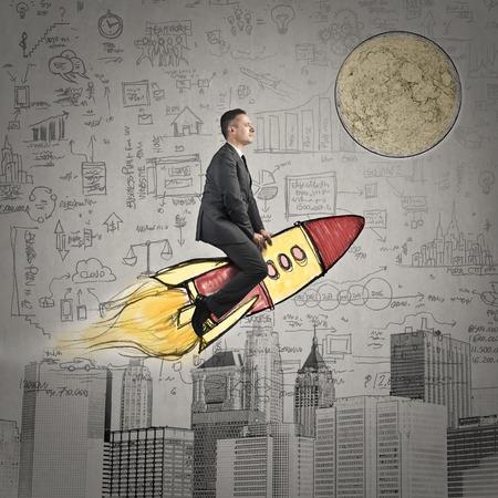 headed: Businessman headed to the moon Stock Photo