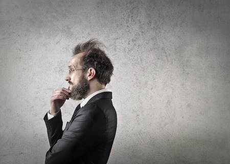absorbed: Businessman absorbed in thoughts