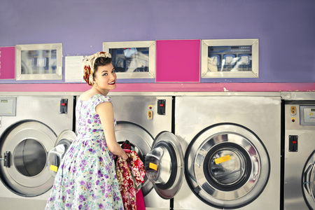 vintage woman: Woman doing the laundry in a vintage room