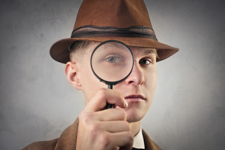 magnifying glass: Suspicious man