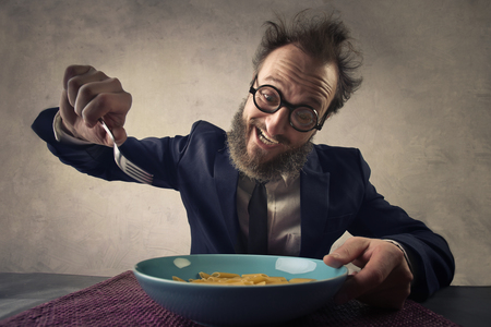 ironic: Hungry man eating his meal Stock Photo