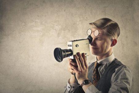 video camera: Retro man filming Stock Photo