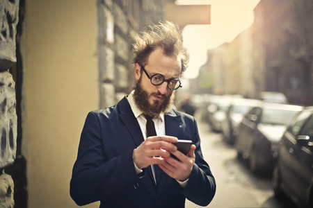 admission: Businessman with smartphone
