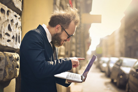Businessman using his pc