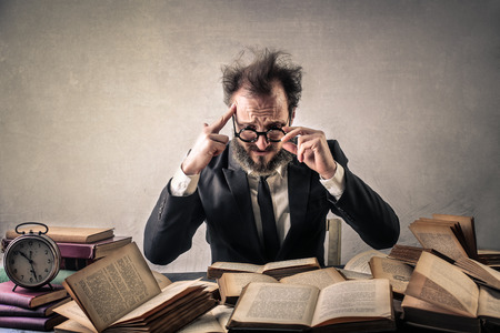 Desperate man in front of books
