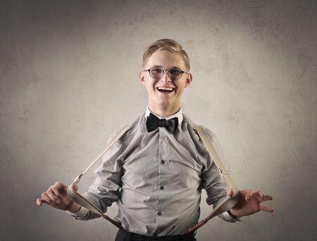 face work: Retro dressed man wearing braces