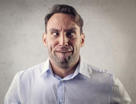 smirk: Crazy man with a weird look