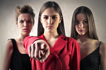 judging: Three girls judging Stock Photo