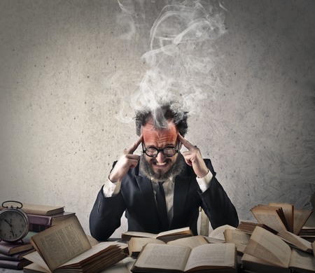 stressed out: Stressed out reading books Stock Photo