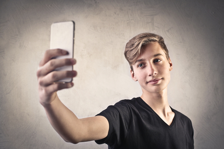 Teenager doing a selfie 写真素材