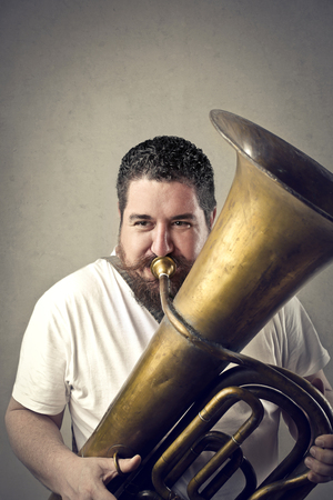 trombone: Chubby man playing trombone Stock Photo