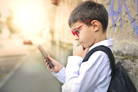 Young boy checking his phone