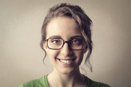 gratified: Smiling woman with glasses