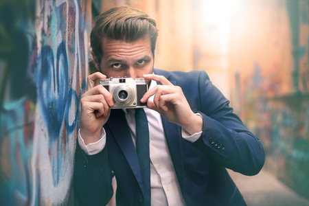 charisma: Handsome man taking a picture