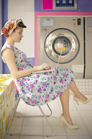 laundry room: Classy lady waiting in the laundry room