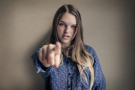 designate: Blonde woman pointing Stock Photo