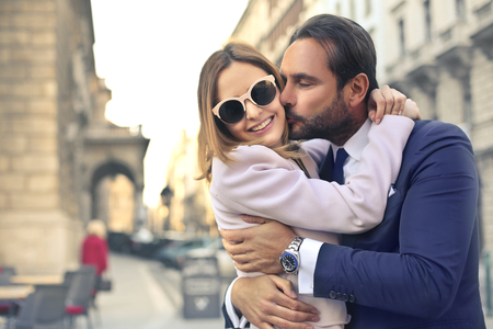 tenderly: Man tenderly kissing his girlfriend