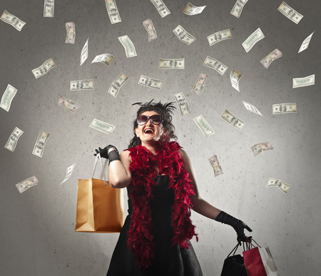 spendthrift: Happy woman doing shopping