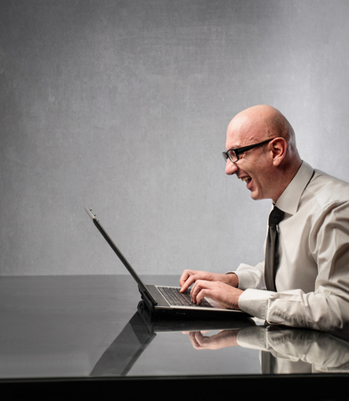 Excited man using his laptop photo