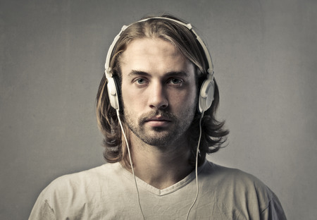 Blonde man wearing headphones photo