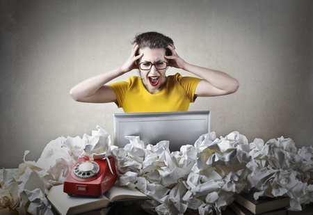 paperball: Desperate writer at work Stock Photo