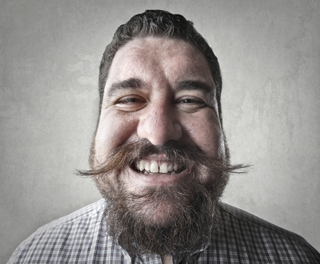 mustache: Chubby man with mustache smiling