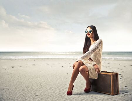 women sitting: Model traveling to the seaside