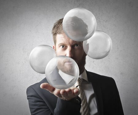 Managerholding transparenten Kugeln Standard-Bild