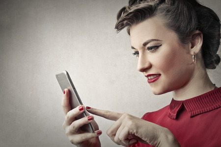 detail internet computer: Classy woman using a smartphone Stock Photo