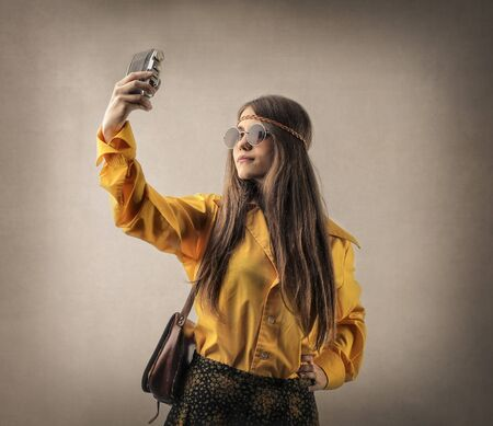 hippie girl: Hippie girl doing a selfie