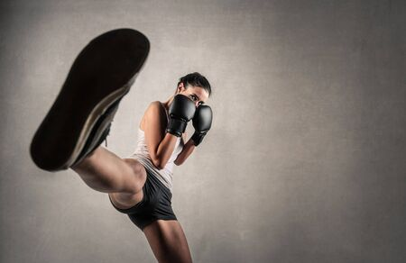 girl kick: Athlete training for a competition