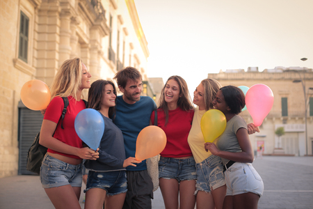 people laughing: Girls celebrating with a man