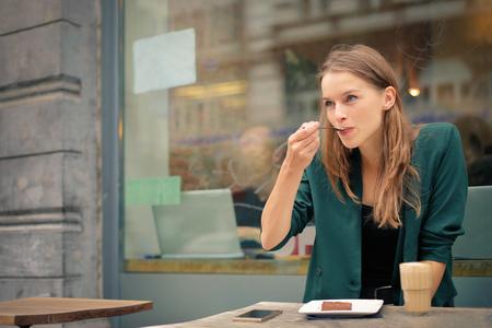 Woman having breakfast Foto de archivo