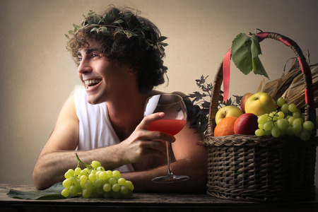 bacchus: Laughing Bacchus holding a glass Stock Photo