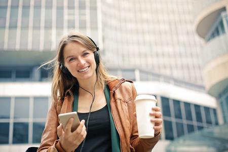 Happy woman going to work Stockfoto