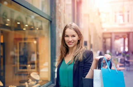 Joyful woman doing shopping