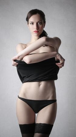 undressing woman: Beautiful woman undressing herself Stock Photo