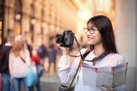 Tourist photographing a monument Archivio Fotografico