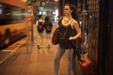 street night: Young woman waiting in the street