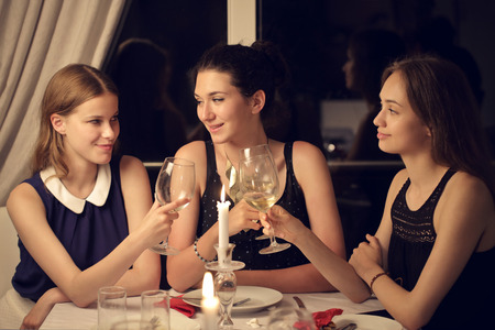 Three friends chatting together photo