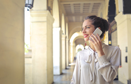 classy woman: Classy woman doing a phone call Stock Photo
