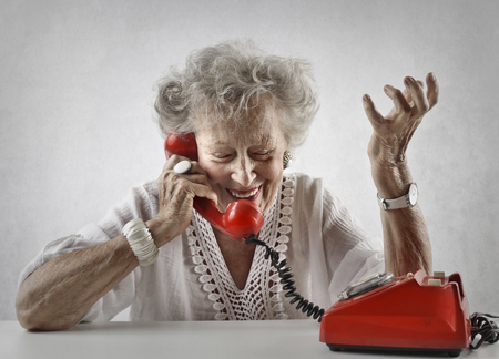 telephone: Elderly woman talking on the phone